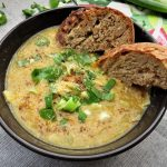 Aromatic Green Lentil Soup with Celery Root served in a bowl with toasted bread
