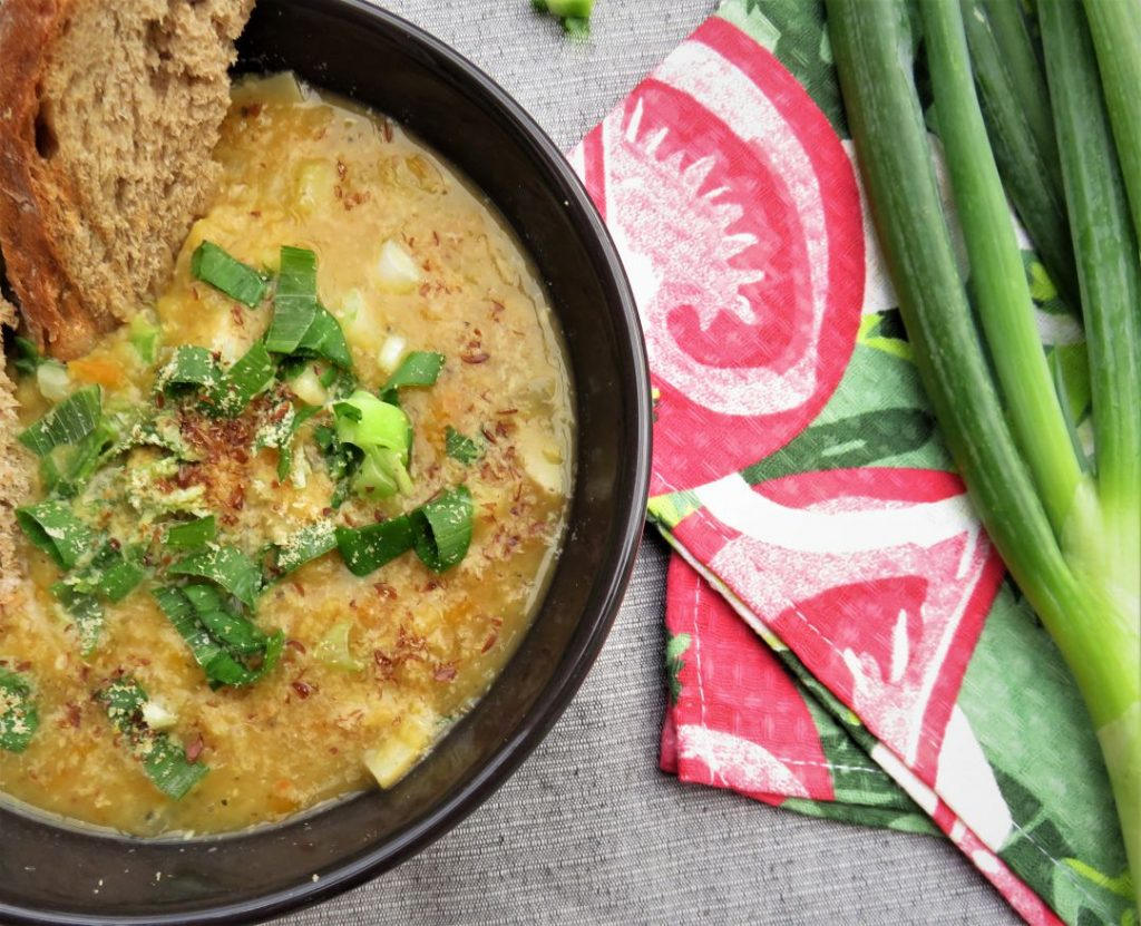 Aromatic Green Lentil Soup with Celery Root served in a bowl
