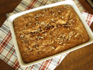 Easy Vegan Whole-Wheat Seed Bread in a baking tray