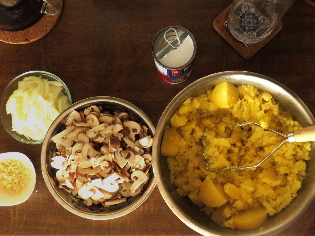 Main indredients for Mushroom Shepherd's Pie: potatoes, mushrooms, onions, garlic and coconut milk