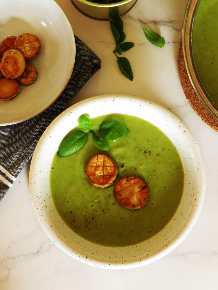 Broccoli cream soup with green peas, basil and vegan scallops