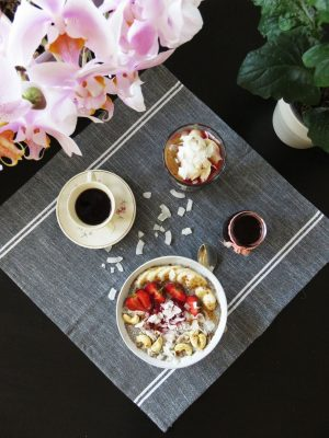 Strawberry & Banana Chia Pudding served with coffee