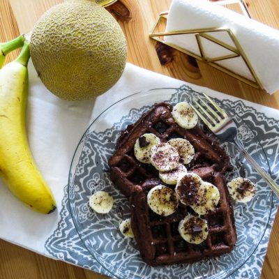 Whole-Wheat Brownie Waffles served with chocolate and banana