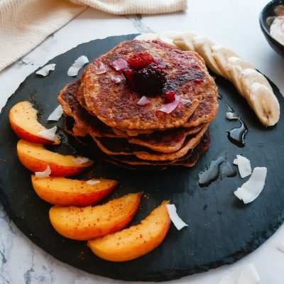 Wholesome vegan protein pancakes with RED LENTILs served with fruits on a platter